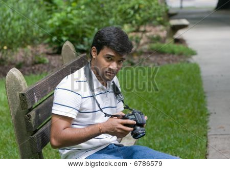 Middle Eastern Man Holding Camera