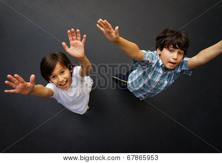 Child jumping on trampoline, high angle