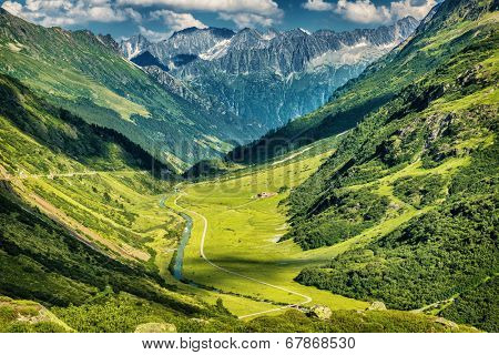 Majestic mountains view, little river in the mountainous valley, beauty of fresh green nature, panoramic landscape, traveling and tourism concept