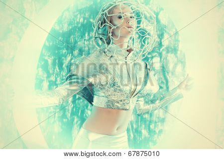 Beautiful young woman in silver latex costume with futuristic hairstyle and make-up. Sci-fi style.