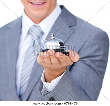 Close-up Of A Businessman Holding A Service Bell