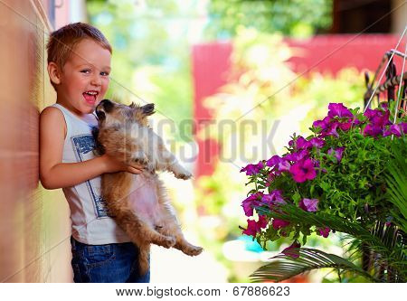 Excited Boy Holding Beloved Puppy