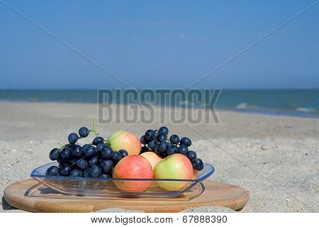 Still -life With Apples And Grapes On The Sandy Shore Of The Sea