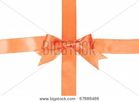Crossed orange ribbons with bow