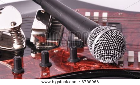 A Microphone Lying On A Guitar