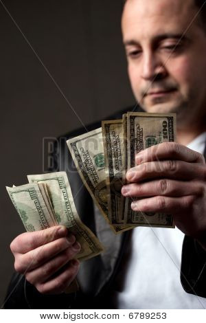 Man Counting Cash