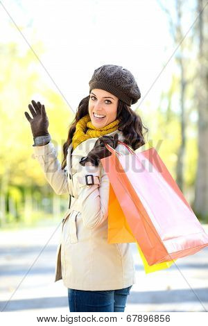 Woman With Shopping Bags On Autumn