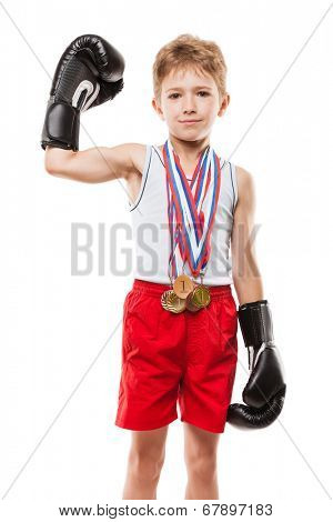 Martial art sport success and win concept - smiling boxing champion child boy holding first place victory gold medal award