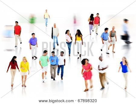 Multi-Ethnic Group of People Walking in Blurred Motion