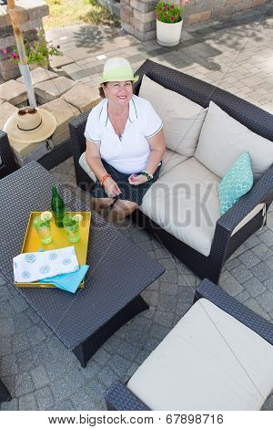 Friendly Attractive Senior Woman On A Patio