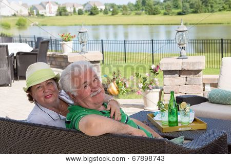 Elderly Couple Enjoy A Relaxing Day On The Patio