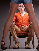 pic of aroused  - a young man sitting astonished by a pair of sexy legs on high heels and gorgeous shorts - JPG