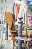 image of thrift store  - old arm chair and stuff on a flea market - JPG
