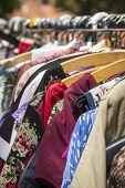 image of thrift store  - clothes on a rack on a flea market.