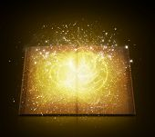 stock photo of bible story  - Old open book with magic light and falling stars - JPG