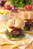 stock photo of beef-burger  - Big and tasty beef burger with cheese and vegetables - JPG