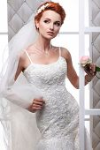 stock photo of evening gown  - A photo of sexual beautiful bride in a wedding - JPG