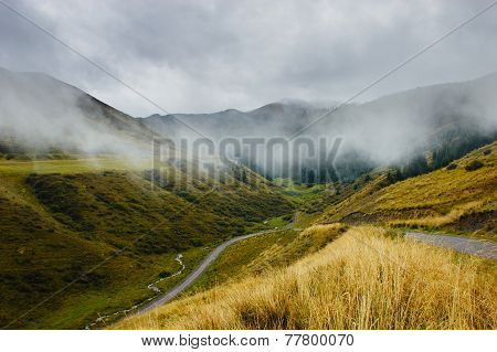 Mountains Under Mist