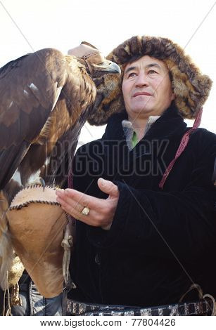 Nura, Kazakhstan - February 23: Eagle On Praying Man's Hand In Nura Near Almaty On February 23, 2013