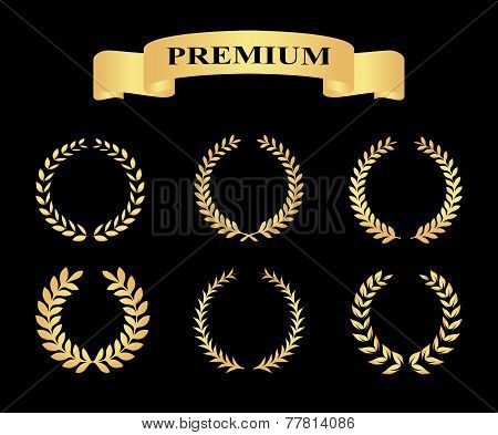 Set of golden silhouette circular laurel foliate and wheat wreaths depicting an award achievement he