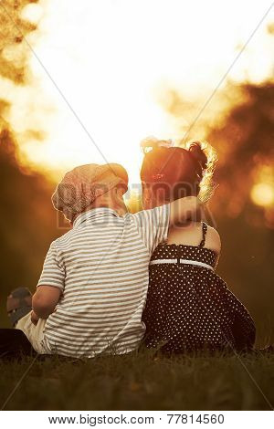 lovely boy and girl on sunset