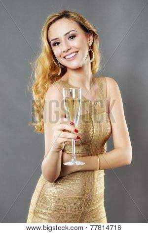Beautiful woman having a glass of champagne