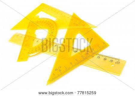 yellow set of measuring tools on white background
