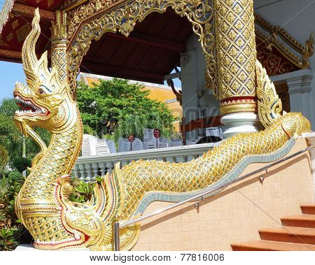 Dragon Serpent, gleaming gold.