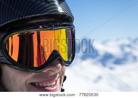 Skier in high mountains during sunny day.