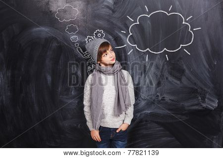 The Boy Looks At A Cloud Drawn On The Chalkboard