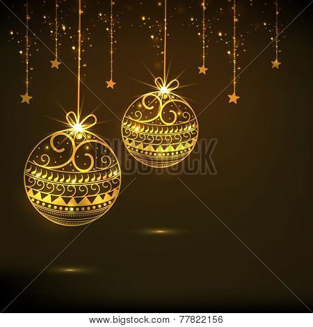 Beautiful floral design decorated golden X-mas Balls and stars hanging on brown background for Merry Christmas and Happy New Year celebrations.