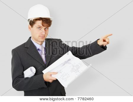 Young Engineer - Building Specialist In Helmet With Drawing