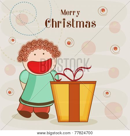 Cute little girl celebrating Merry Christmas festival with gift box on stylish background.