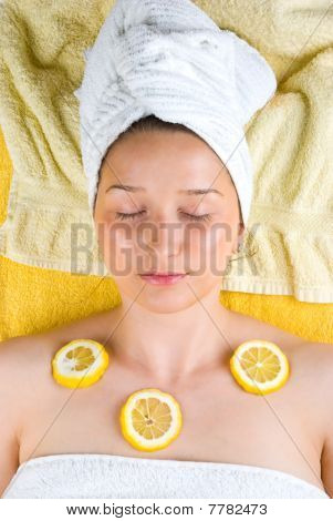 Woman At Spa With Lemon On Skin