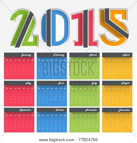 Colorful annual calendar with creative text 2015 on grey background for Happy New Year celebrations.