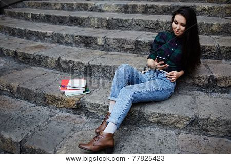 Asian race student girl browsing the internet with cell phone