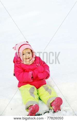 Girl Sits On Snow