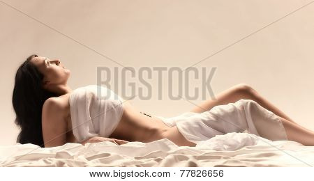 Woman And White Sheets