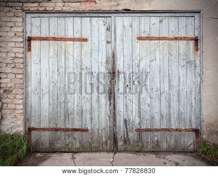 Old Wooden Neglected Garage Door.