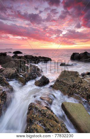 Dramatic sunset at the coastline of Kota Kinabalu