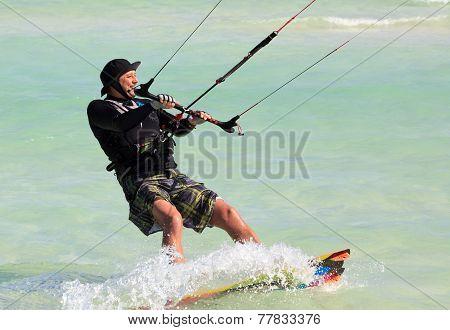 Man riding his kiteboard. Cayo Guillermo in Atlantic Ocean.
