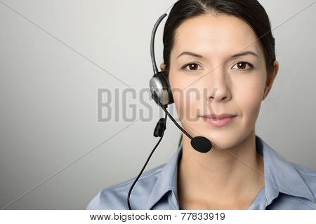 Attractive Call Center Operator Wearing A Headset