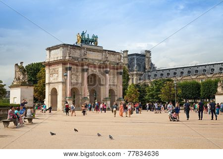 Tourists Walk Near The Triumphal Arch. Paris, France