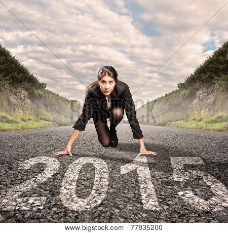 businesswoman on a road ready to run