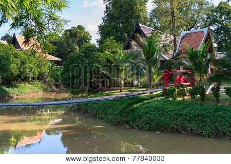 Tropical Park With Wooden Long Rope Bridge
