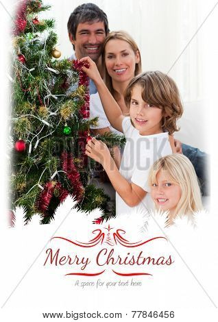 Young family decorating a Christmas tree against border
