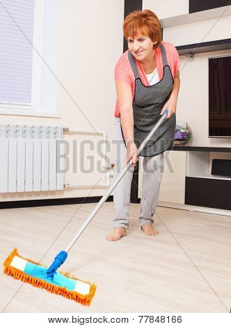 Woman cleaning the floor at home