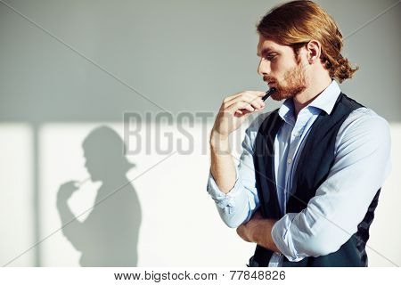 Portrait of pensive businessman in isolation