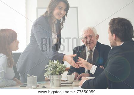 Businesswoman Greeting With Co-workers