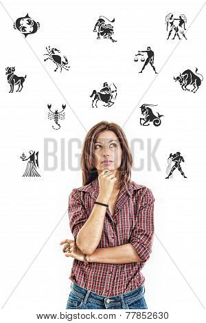 Woman Surrounded With Zodiac Signs Thoughtfully Looking Up With Questionable Face Expression In Jean